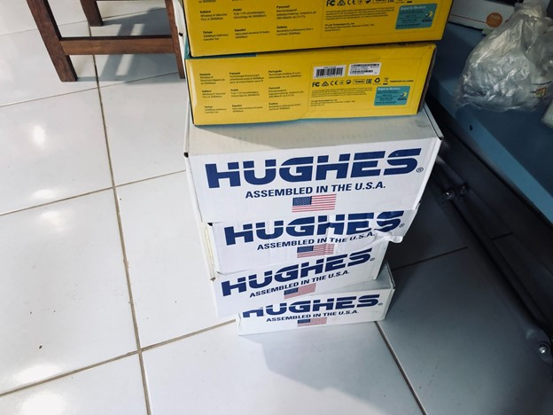 """Humaitá City """"Hughes Internet Service"""" boxes stacked on a floor"""